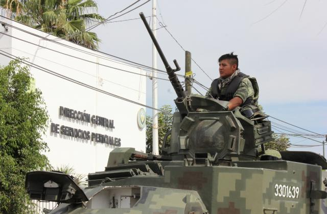 A Mexican soldier mans an armed vehicle outside the Forensic Medical Service after the body of Francisco Zazueta arrived on April 15, 2017. (Photo: Reuters)