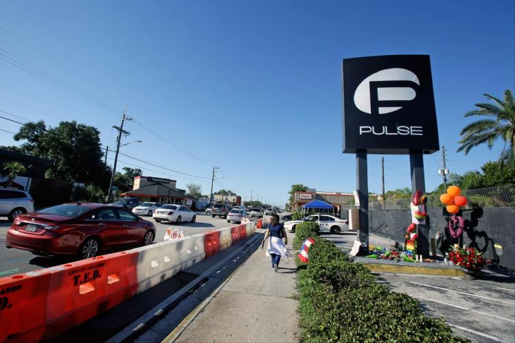 Traffic moves along Orange Avenue after authorities opened the streets Wednesday around the Pulse nightclub, scene of the recent mass shooting that killed 49 people. (Photo: Associated Press)