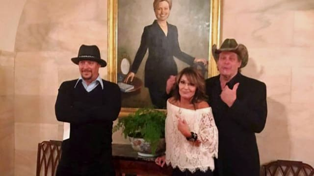 The trio pose mockingly in front of a portrait of former first lady and Secretary of state Hillary Clinton. (Photo: Sarah Palin)
