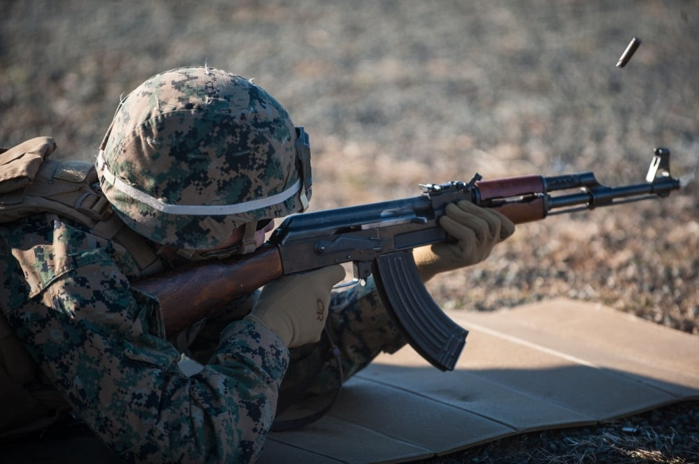 A United States Marine fires an AK-47 Tuesday, Jan. 13, 2015, Range 2 at The Novo Selo Training Area in Bulgaria. The U.S. Marines was among four partner nations participating in exercise Platinum Lion 2015. (Photo: Department of Defense)