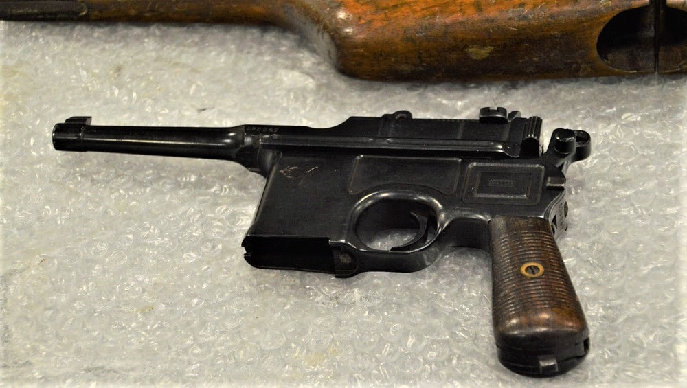 A wartime commercial Mauser-marked C96 Broomhandle complete with its wooden stock/holster