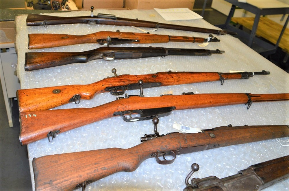 A selection of captured bolt-action infantry rifles from around the world.