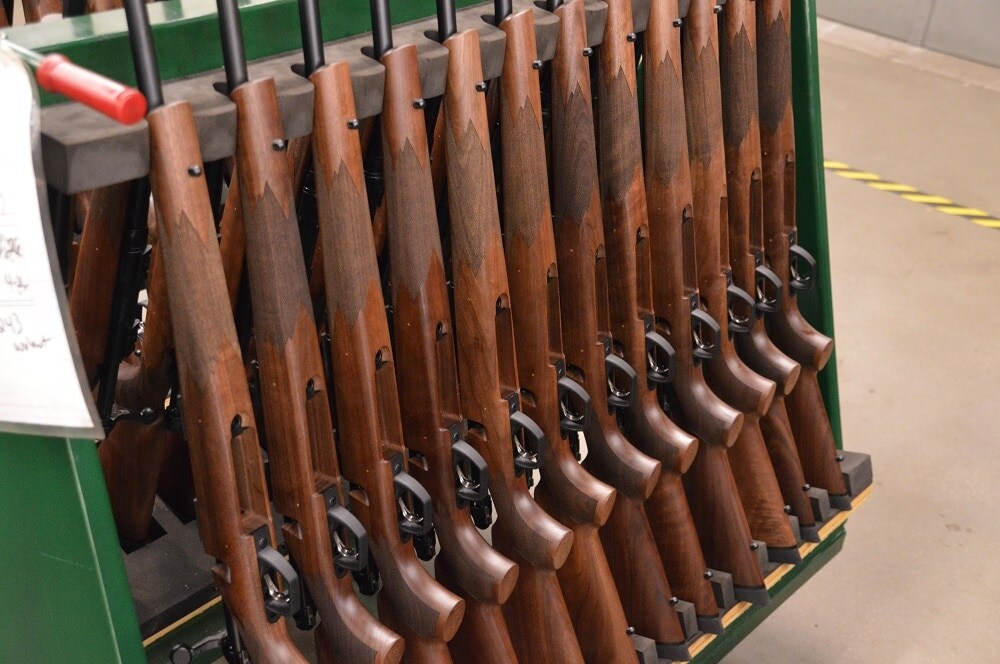 Next to walnut stocked bolt-action hunting rifles