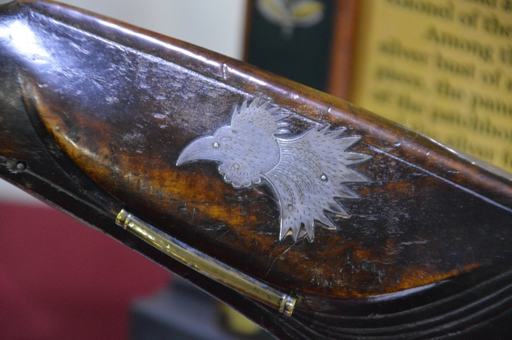 "Higgins, who hailed from South Carolina, made this ""Gamecock"" flintlock rifle around 1825."