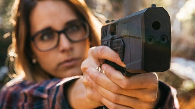 A woman demonstrating the pointability of the Maxim 9 pistol. (Photo: SilencerCo)