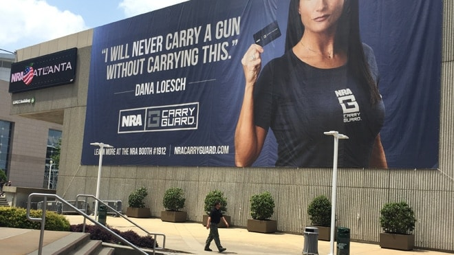 The NRA draped a sign over the side of the Georgia World Congress Center to promote the new self-defense insurance. (Photo: Daniel Terrill/Guns.com)