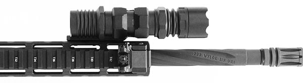 The UTG Offset Flashlight Ring Mount with M-LOK allows shooters to mount flashlights forward to free up space on shorter hand guards. (Photo: Leapers UTG)