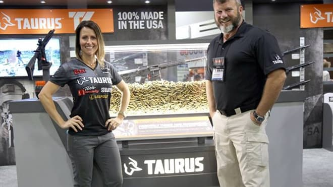 The face of Taurus USA, Jessie Duff, left, posing with a company rep at 2017's NRA show in Atlanta. (Photo: Taurus/Facebook)