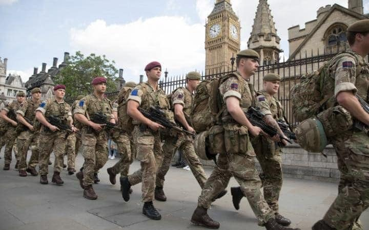 Troops arrive to guard parliament as part of Op Temperer. Note the red berets which typically denote members of the 16th Air Assault Brigade (Photo: Eddie Mulholland/Telepgrah)