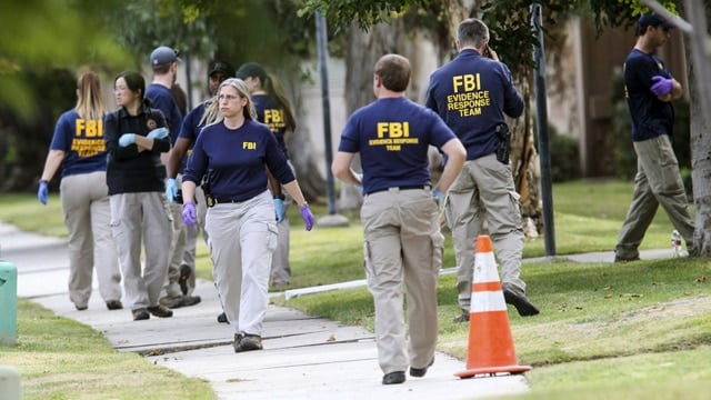 FBI pictured outside the San Bernardino shooters' house in December 2015. (Photo: Ringo H.W. Chiu/AP Photo)