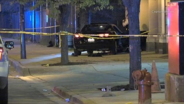 Chicago Police work the scene of a shooting on the west side. (Photo: Captured News)