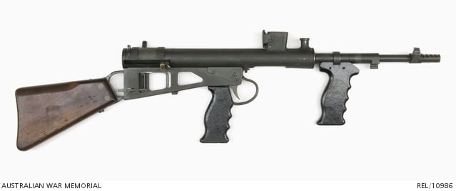 "The WWII era guns were refurbished at the Australian Lithgow Small Arms factory in the 1950s and given new MkIII style barrels and a safety catch. This is a good example of the latter type of ""improved"" Mk2/3 Owen."