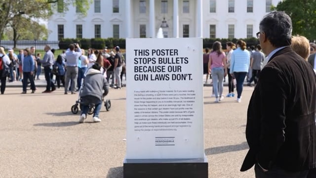 Americans for Responsible Solutions placed a bullet proof poster in front of the White House in support of expanded background check laws. (Photo: AdWeek)