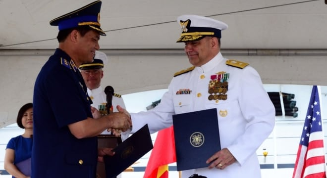 Lt. Gen. Nguyen Quang Dam, commandant, Vietnam coast guard, and Coast Guard Rear Adm. Michael J. Haycock shakes hands during a transfer ceremony at Coast Guard Base Honolulu, May 25, 2017. The cutter, now CSB-8020, will continue to serve the maritime community on the opposite side of the Pacific under a new flag. (Photo: U.S. Coast Guard)