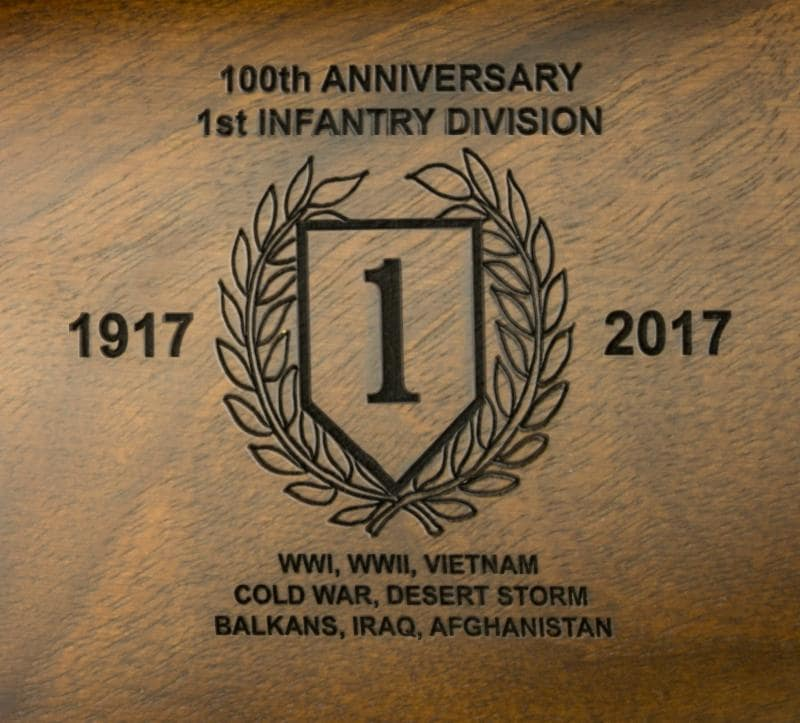 The engraving featured on the commemorative M1 Carbine's stock celebrating the 1st Division. (Photo: Inland Manufacturing)