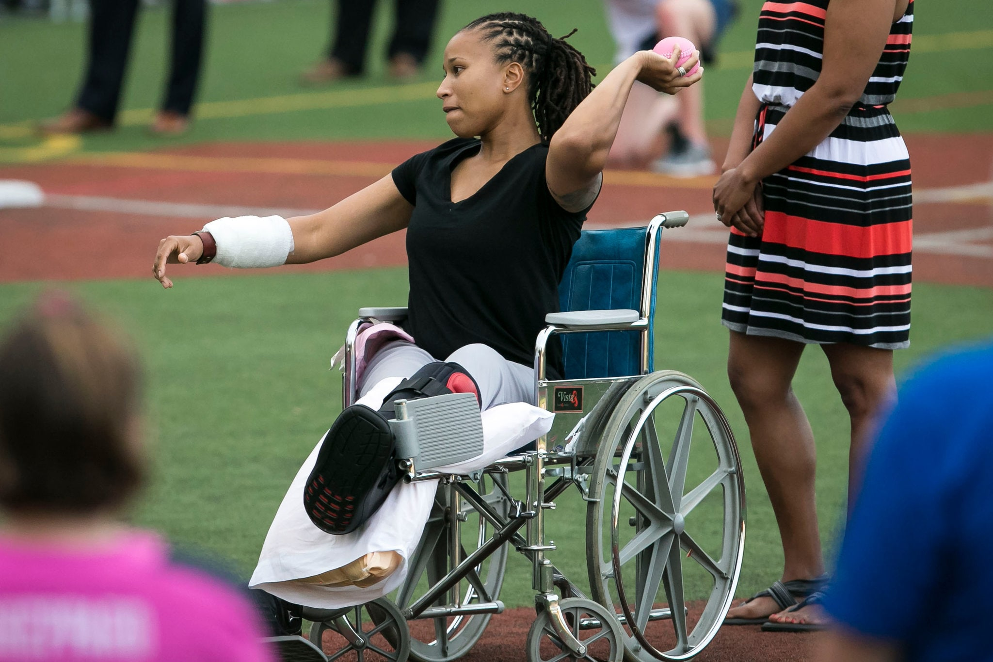 Crystal Griner, a Capitol Police officer injured in last week's shooting at a congressional baseball practice, threw the first pitch at the annual Congressional Women's Softball Game in Washington on Wednesday. (Photo: Al Drago/The New York Times)