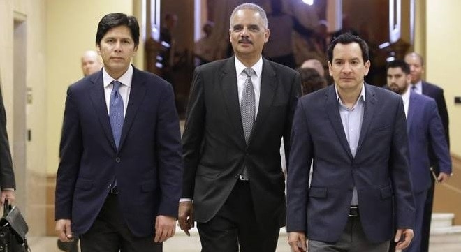 Former U.S. Attorney General Eric Holder, center, seen with California Senate President Pro Tem Kevin de León, and Assembly Speaker Anthony Rendon, D-Paramount, is no longer retained by state lawmakers (Photo: Rich Pedroncelli /AP)