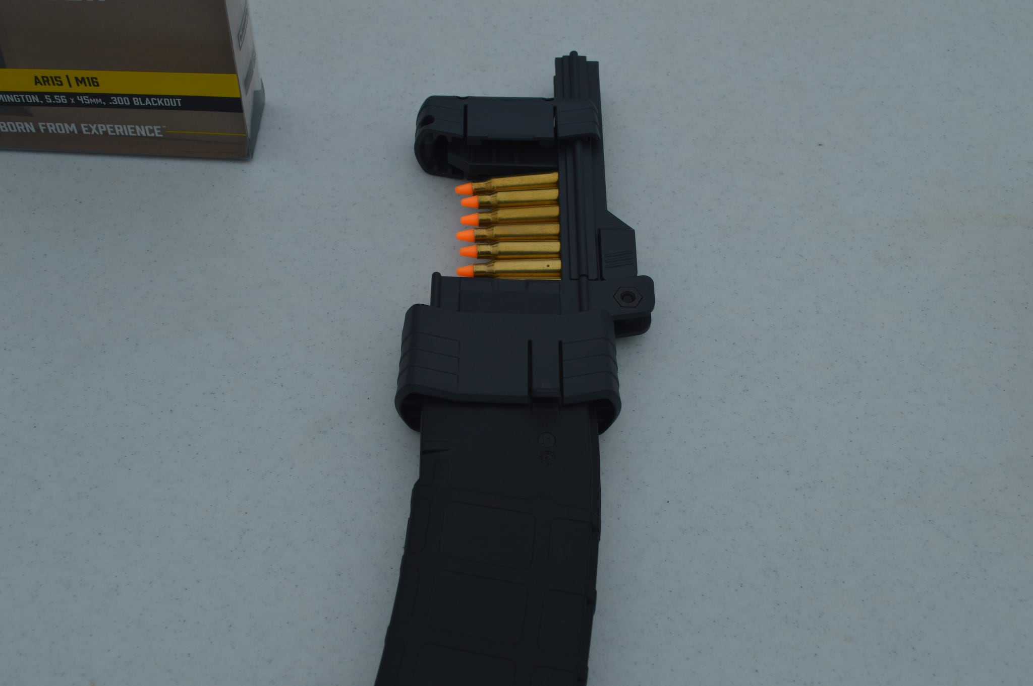 The Butler Creek ASAP AR-mag loader can be used one round at a time, fed with a stripper clip, or as shown here, quickly stacked with up to ten rounds at a crack. An easy press on the handle loads all the rounds in one crack. While this is great for reloading on the range, it would be even better for high volume varmint hunters. (Photo: Kristin Alberts)