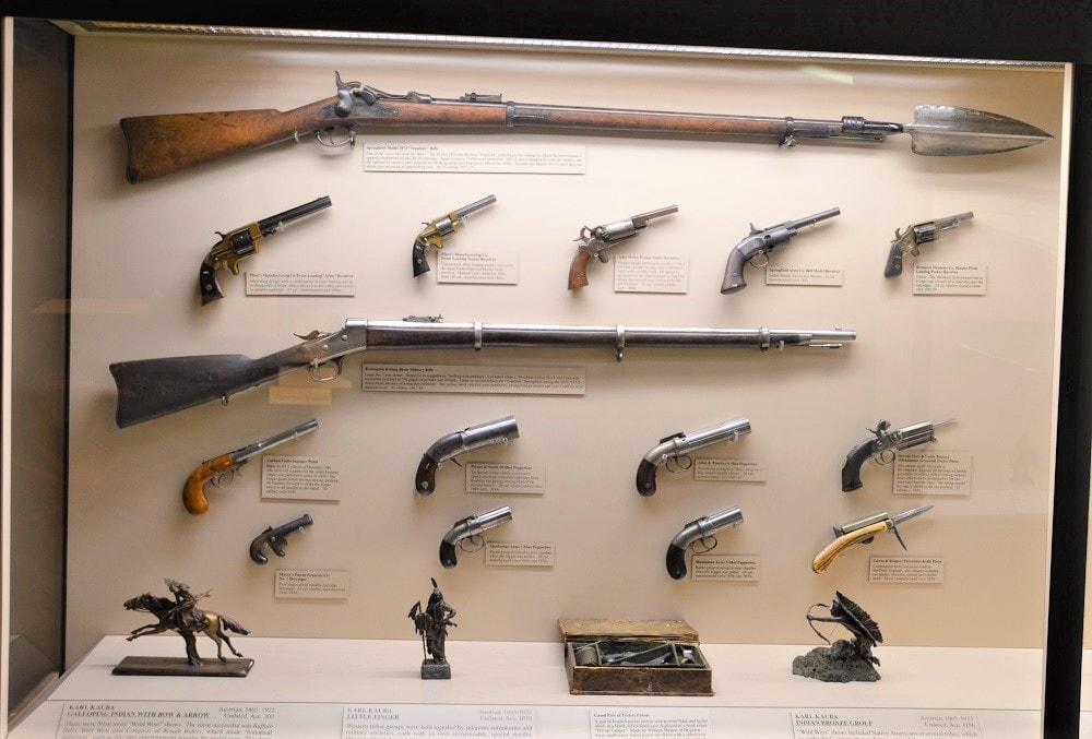How about a collection of revolvers and pistols from the Indian Wars era, topped off with an 1873 Springfield Trapdoor cartridge conversion-- complete with the trowel bayonet that also allowed frontier troopers to dig it as needed.