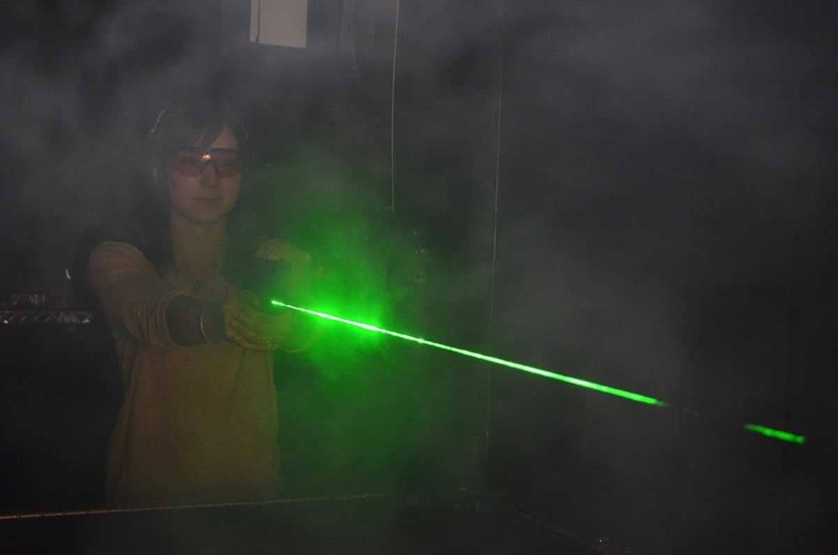 Green lasers offer greater visibility over traditional sights in low light shooting. (Photo: Crimson Trace)