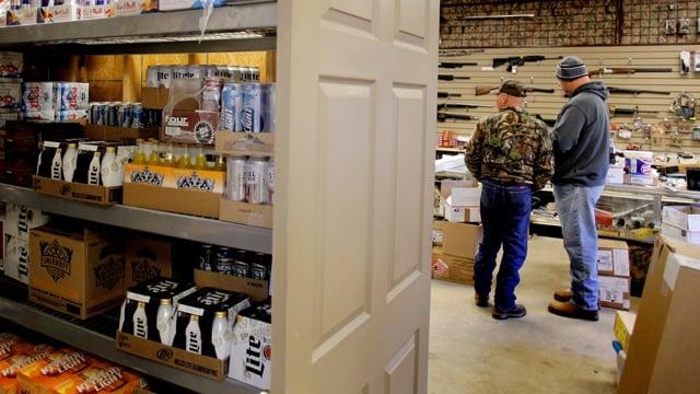 Customers shop at The Brickyard Carry Out & Drive Thru and gun store in Gouster, Ohio. (Photo: Calvin Mattheis/CalvinMattheis.com)