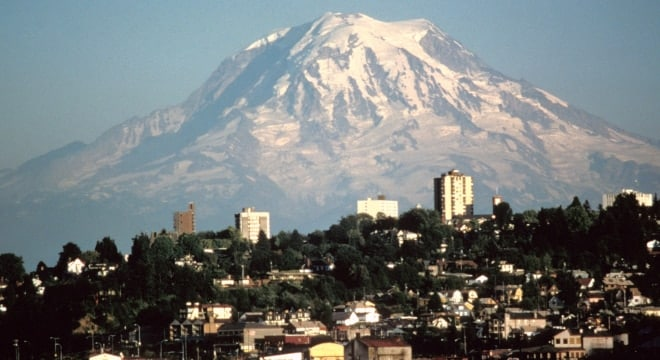 Mount Rainer over Tacoma, one of the last cities to drop their bans on Tasers and stun guns. (Photo: Wikimedia Commons)