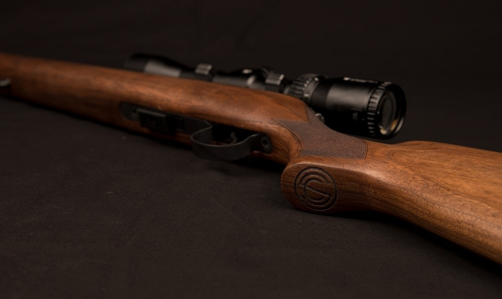 The walnut stock has the distinctive SilencerCo logo subtly engraved on the grip.