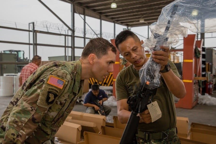 A Philippine Marine and U.S. military official inspect a new M4 carbine during a weapons and equipment delivery. (Photo: U.S. Embassy)