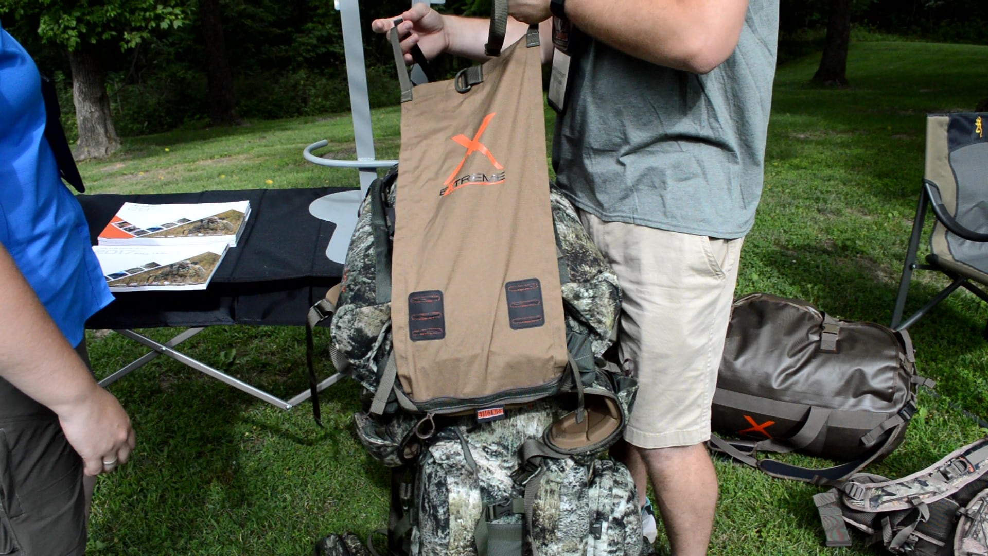 Here we see the built-in, stowaway meat shelf which pulls out from the bottom of the pack. Hunters can easily tuck several quarters of big game behind this shelf, while the pack's side wings flare out to lash down the load. (Photo: Kristin Alberts)