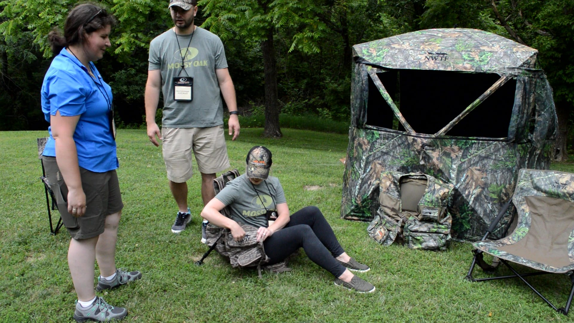 Zach and Sarah from Alpz Brands show off their NWTF vests and blinds for turkey hunters. Here, Sarah demonstates the comfort of the Grand Slam vest, built with a removeable kickstand frame, adjustable legs, and a foldaway padded seat. (Photo: Kristin Alberts)
