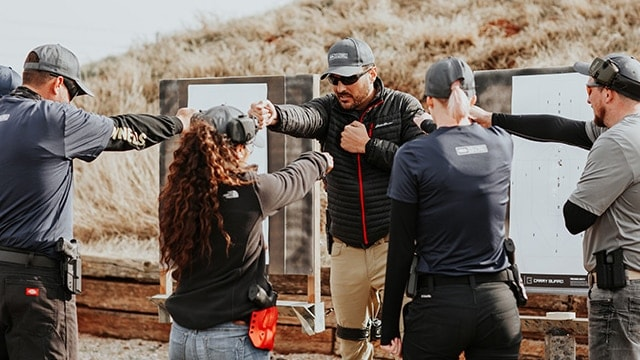Stock image of an NRA Carry Guard training course in which everyone has a Glock, Sig or the equivalent.