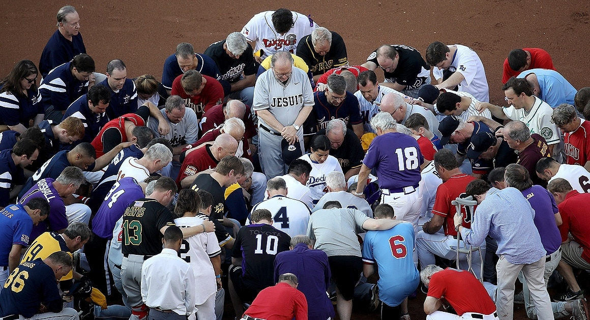 Members of the Republican and Democratic congressional baseball teams gather for a bipartisan prayer before the start of the congressional baseball game at Nationals Park on Thursday. U.S. House Majority Whip Rep. Steve Scalise (R-La.) is in critical condition following a shooting Wednesday during a Republican congressional baseball team practice. Four others were also wounded and the gunman was killed. Getty