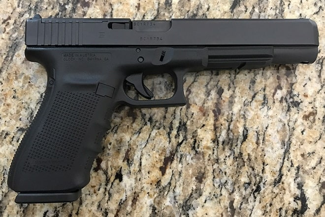 glock 40 handgun on granite