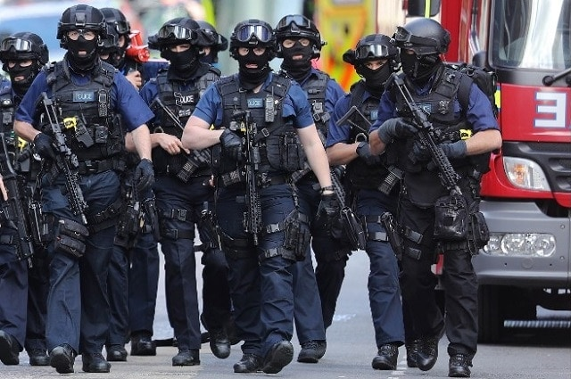 Counterterrorism officers patrol the area near a recent attack on London Bridge. (Photo: Getty Images)