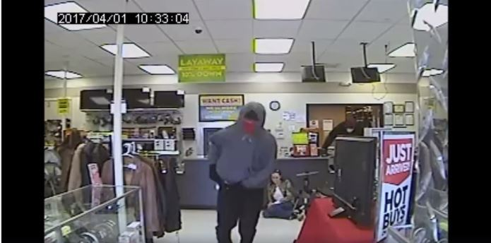 Oklahoma City Police release surveillance video screenshot of one of the suspects in an armed robbery at Fast Cash Pawn on May 22, 2017. (Photo: NBC 4 News)