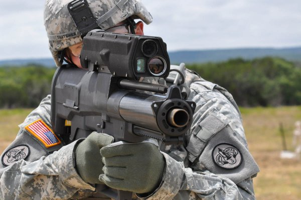 An Army soldier aims the XM25 Counter-Defilade Target Engagement System, a 25mm airburst grenade launcher the military sought to procure. (Photo: Department of Defense)