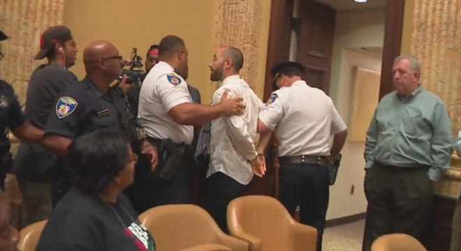 Two were arrested after a scuffle following lengthy hearings this week on a controversial proposal to establish a mandatory minimum sentence for those found with handguns near Baltimore schools, parks, and other public buildings. (Photo: WBFF)