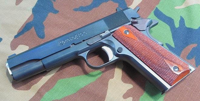 remington r1 1911 on camoflauge background