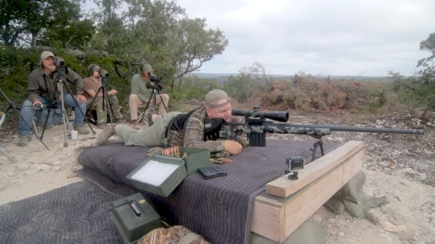 Caption: Jim Spinella pings a target 4,549 yards, or 2.58 miles, with an Extreme Long Range Tactical rifle chambered in 375 Cheytac. (Photo: Hill Country Rifle)