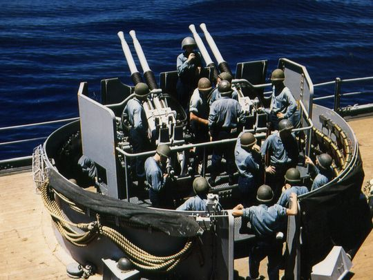 Sailors aboard USS New Jersey man the four barrels of a Quad 40mm Bofors inside a protective steel tub during WWII. She had 20 such tubs filled with 80 guns (Photo: Navy History Command)