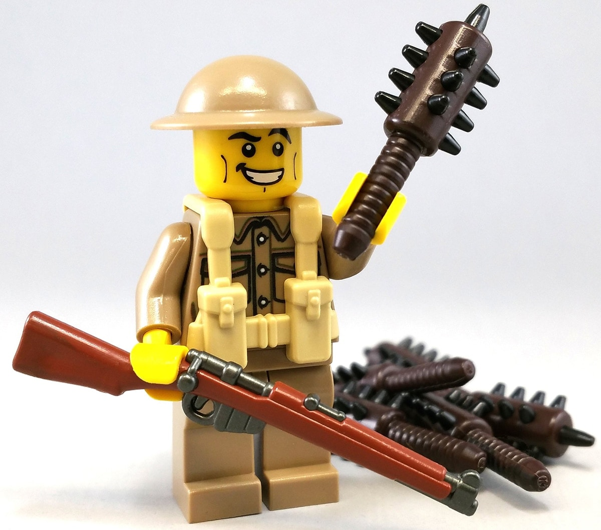 Melding modern with historic, this minifig boasts a rifle in one hand and a mace in the other. (Photo: BrickArms)