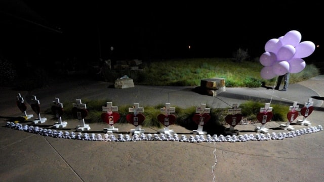 Crosses for those killed in the Aurora movie theater shooting are set up at midnight vigil marking the fifth anniversary of the tragedy. (Photo: Rick Wilking/Reuters)