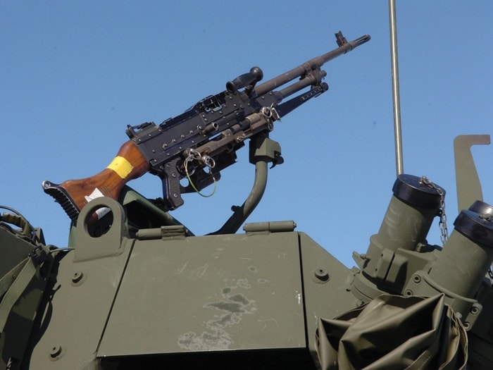 The standard C6, seen above mounted on a Canadian forces armored vehicle, uses wooden furniture
