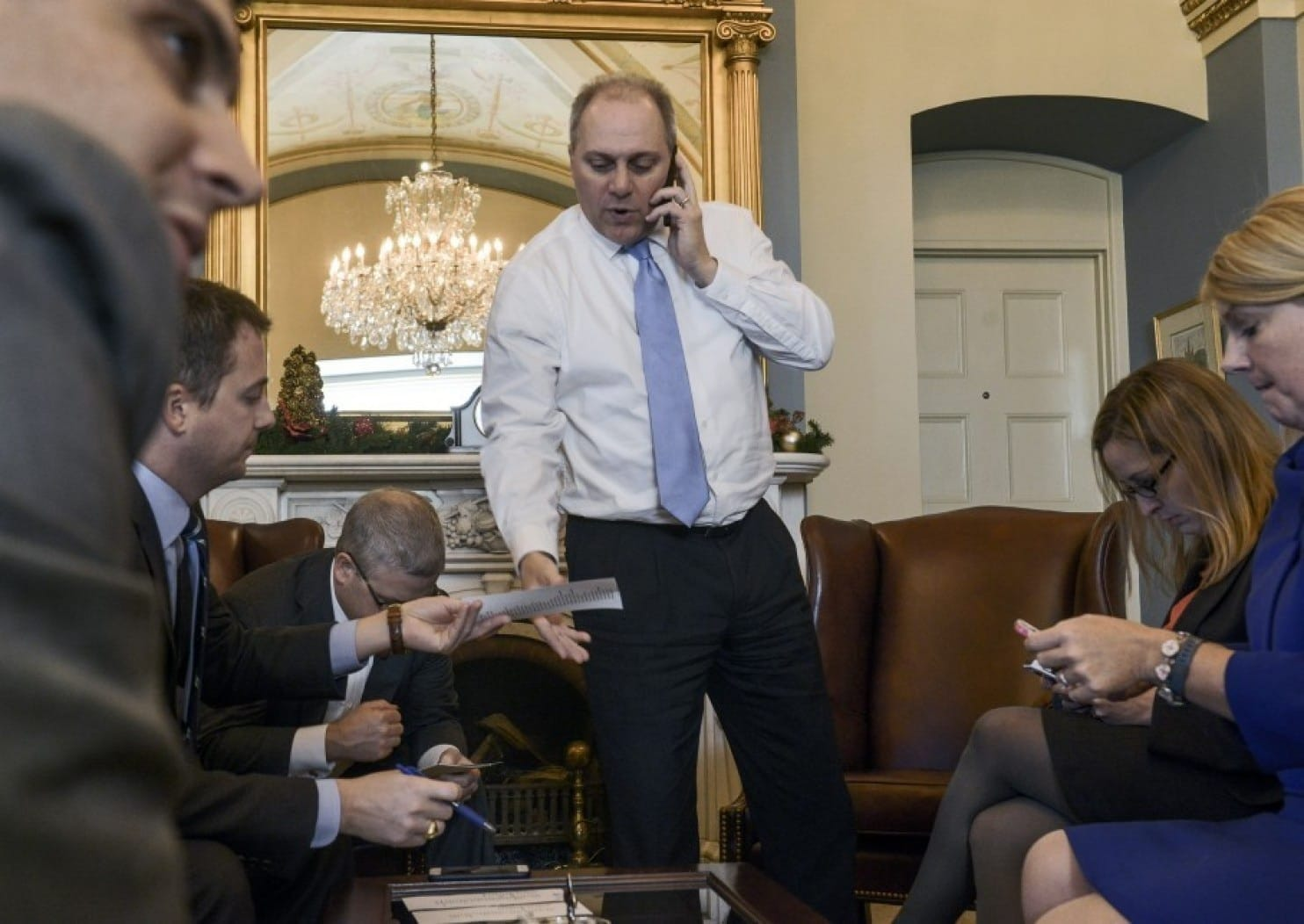 House Majority Whip Steve Scalise (center) meets with staff while checking on his vote count on Dec. 11, 2014, in his Capitol office. (Photo by Bill O'Leary/The Washington Post)