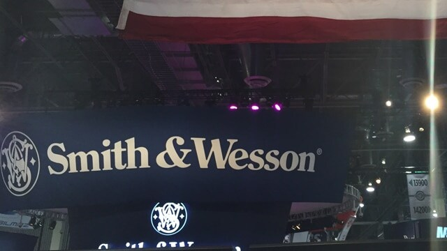 A Smith & Wesson sign below a giant American flag at SHOT Show 2017 in Las Vegas. (Photo: Daniel Terrill)
