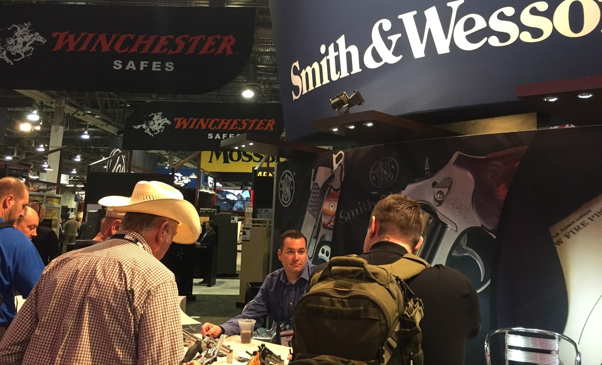 A Smith & Wesson representative admiring (probably) the awe expressed by patrons of Smith & Wesson products during SHOT Show in Las Vegas in January 2017. (Photo: Daniel Terrill)