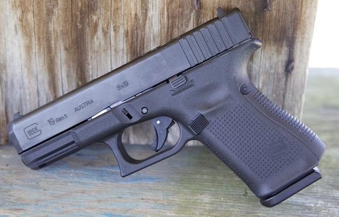 glock 19 gen 5 next to wooden wall