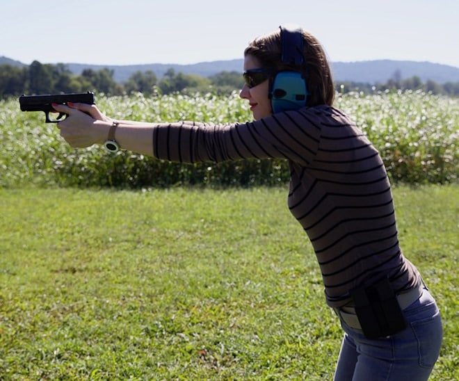 side view of female shooting a glock 19