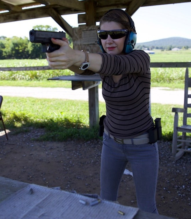 female shooting a glock 19 outdoors