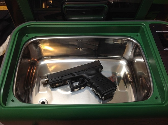 A_Glock_23_set_inside_the_tank_shows_the_large_capacity.__Full_size_pistol_frames_are_no_problem,_as_are_most_common_gun_parts